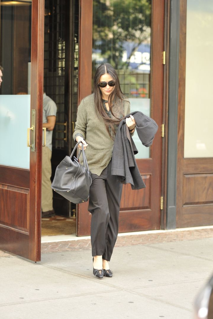 Demi Moore keeps it casual in army green while running errands.