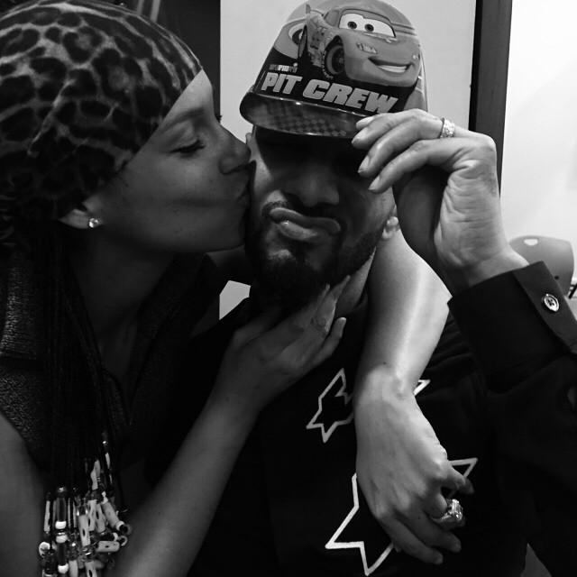 Swizz Beatz gets a big kiss from his wife Alicia Keys.