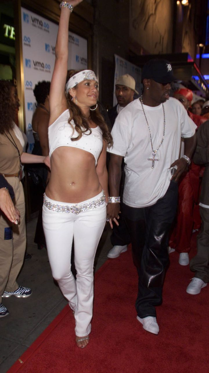 J.Lo & Diddy get live while walking hand-in-hand.