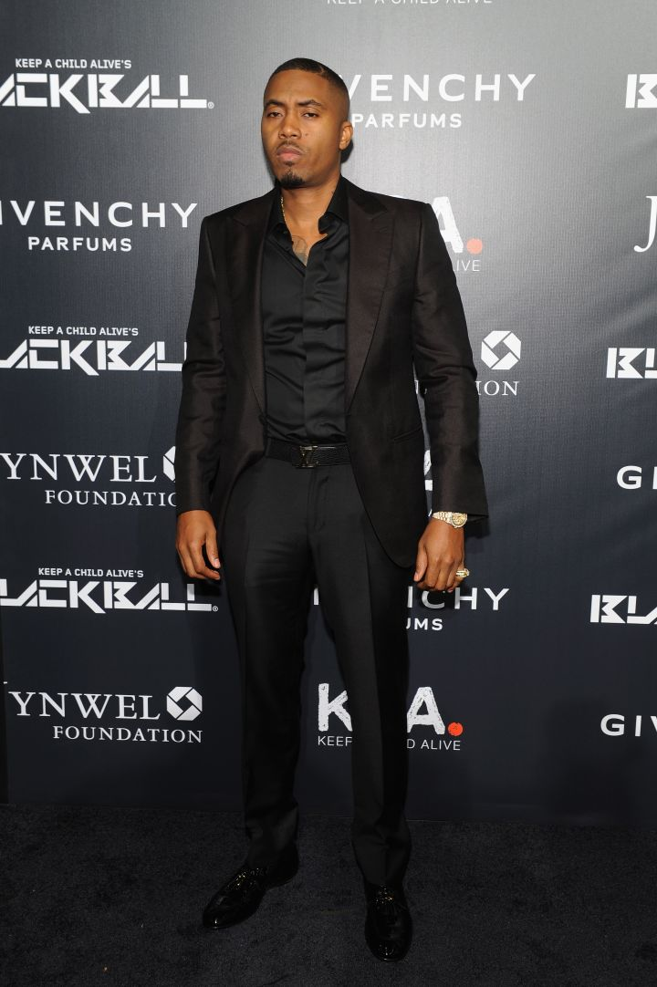 Nas has a handsome mean mug in all black.