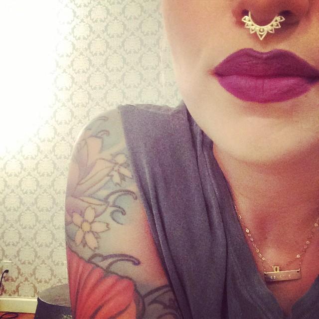 Bold tats and a bold lip.