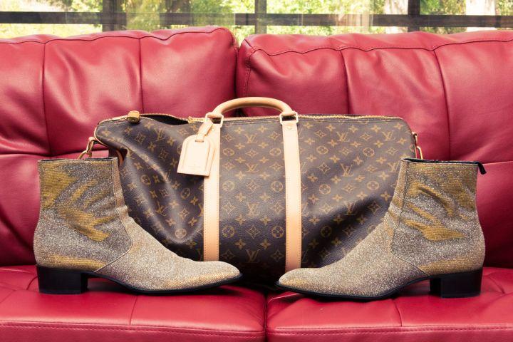 His Louis Vuitton gym bag.