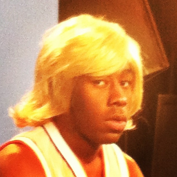 This is Tyler, The Creator with a cute blonde bob.