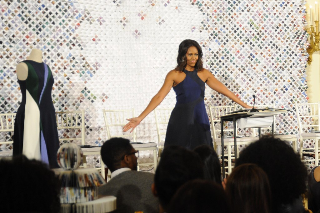 Michelle Obama glows in a student designed dress for the Celebration of Design at the White House in Washington DC