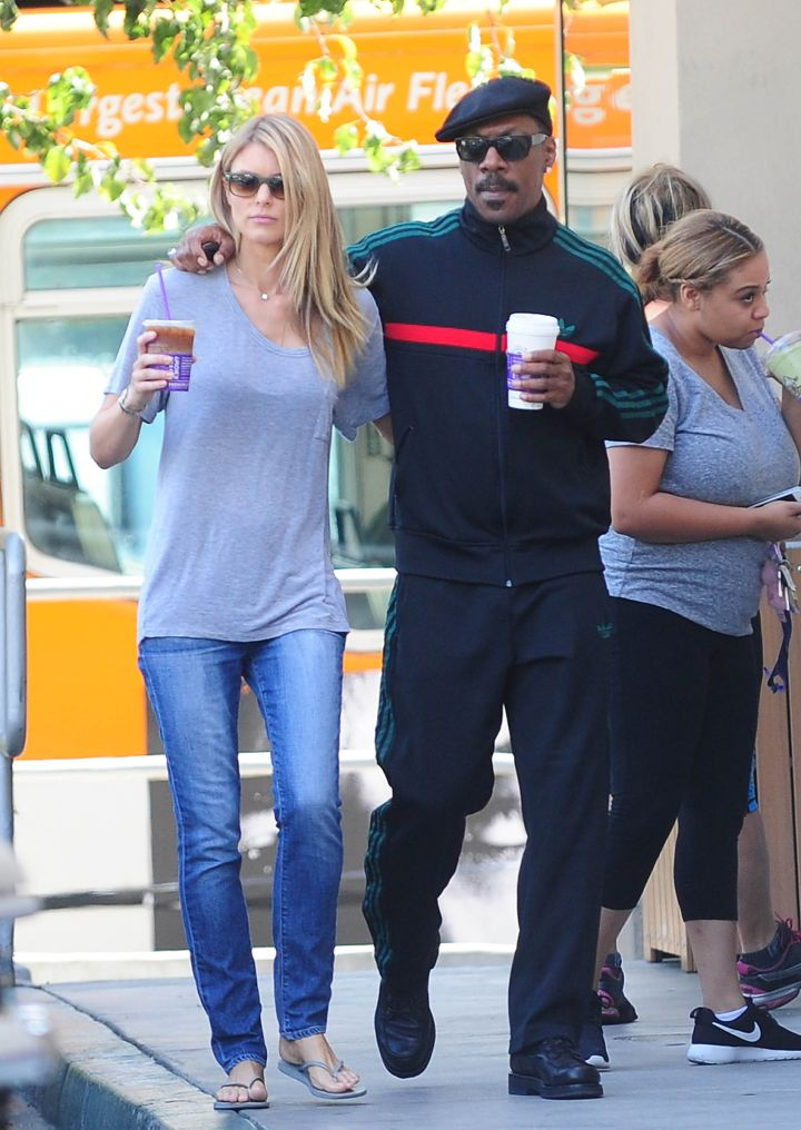 Coupledom: Eddie Murphy and Paige Butcher look might cozy as they go for a coffee run.