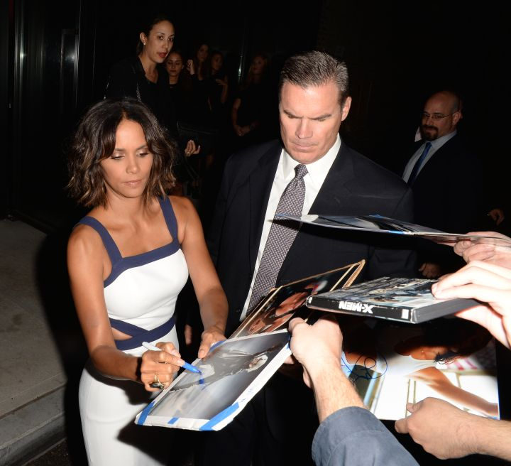 Halle Berry showed off her guns as she signed autographs for fans at the Michael Kors event.