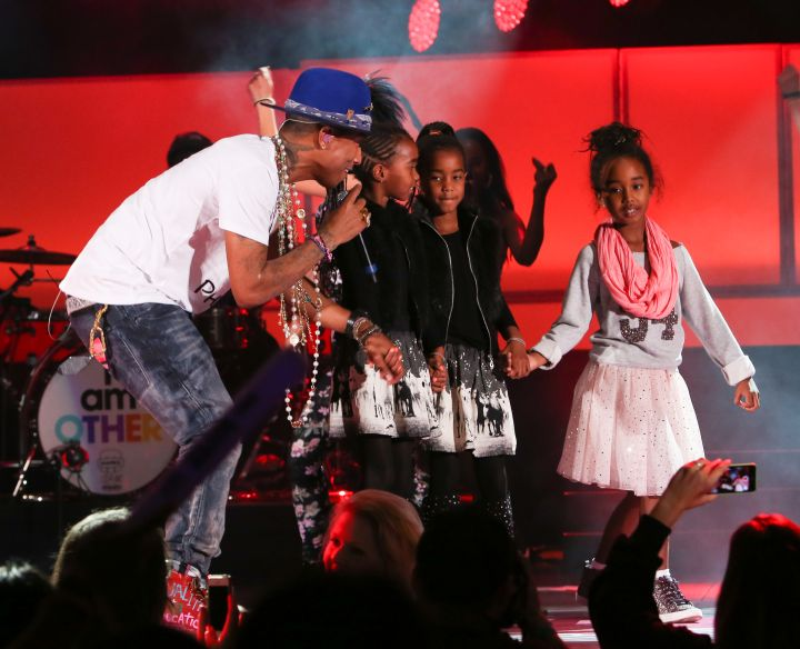 Pharrell gives Diddy's daughters a big hug during his performance at CBS Radio's We Can Survive concert at the Hollywood Bowl in Hollywood, CA.