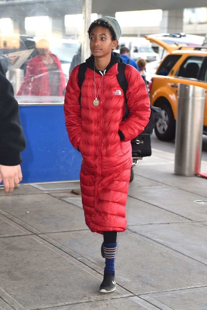 Willow Smith rocked a long red jacket at JFK airport.