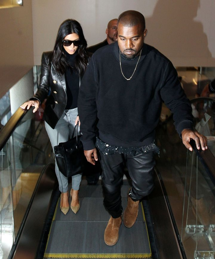 This is what Kanye and Kim look like when they arrive at LAX.