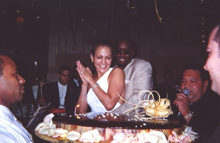 Diddy wraps his arms around his girl as the surprise birthday bash fun begins.