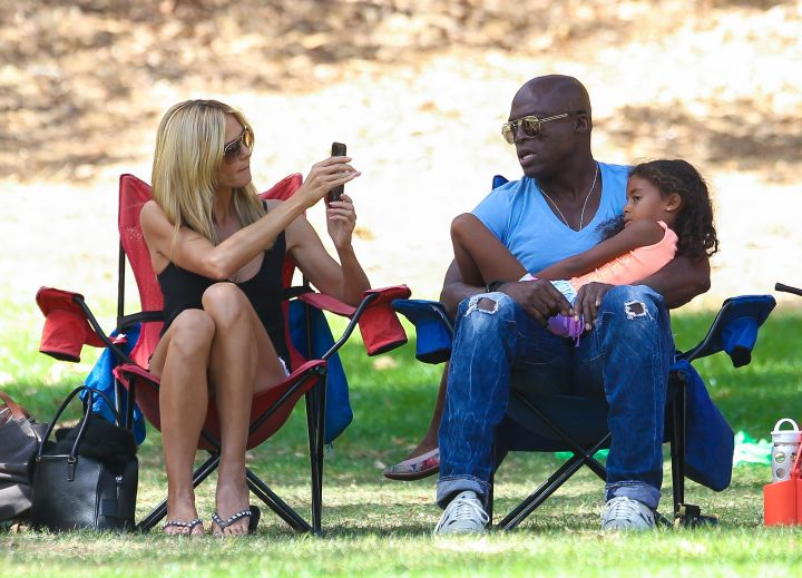 Cheese! Heidi Klum snaps a pic of Seal and their daughter while at their son's soccer game.