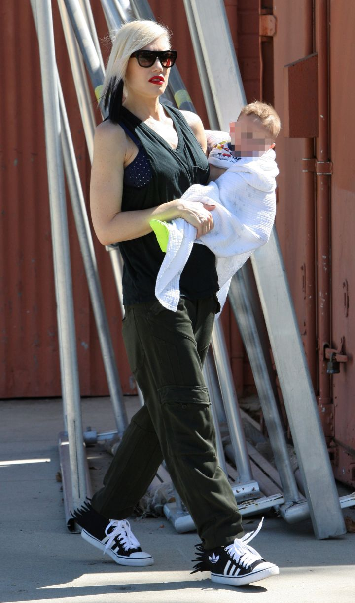 Mother and son cuteness. Gwen Stefani carries little Apollo out and about in L.A.