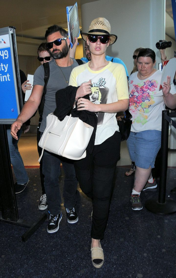 On her grind! Iggy Azalea heads out of LAX looking a little tired.