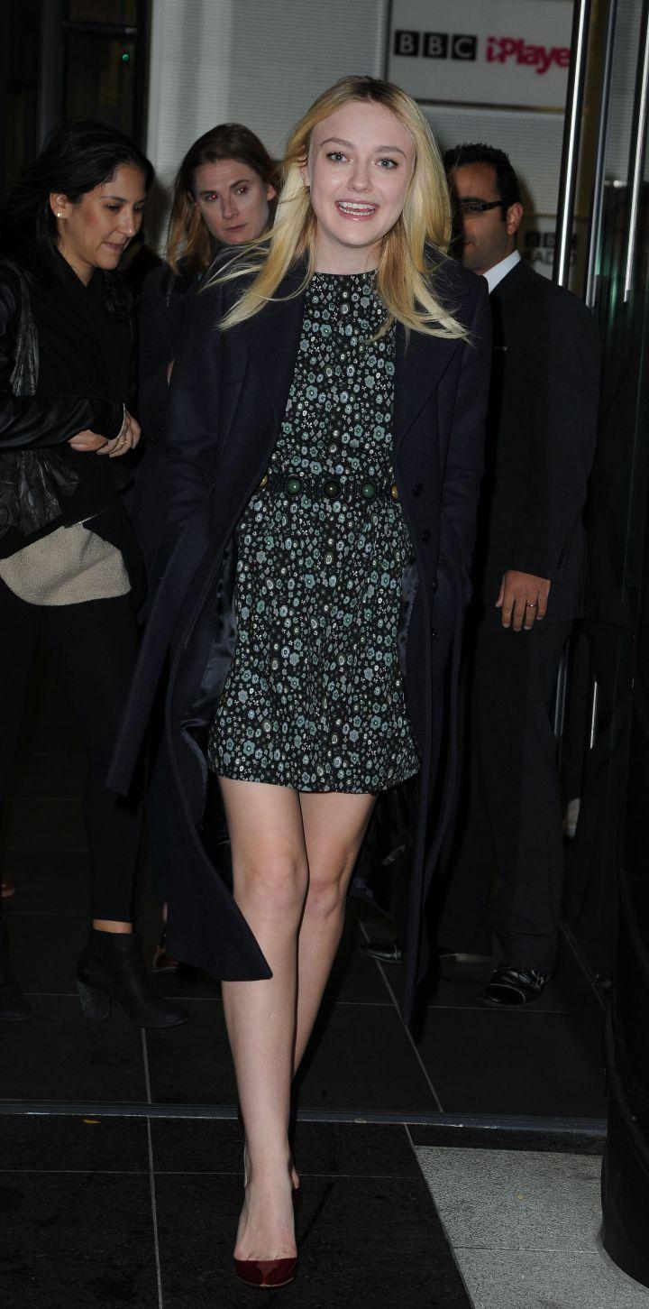 Dakota Fanning flashes a little smirk as she leaves the BBC Breakfast Studio.