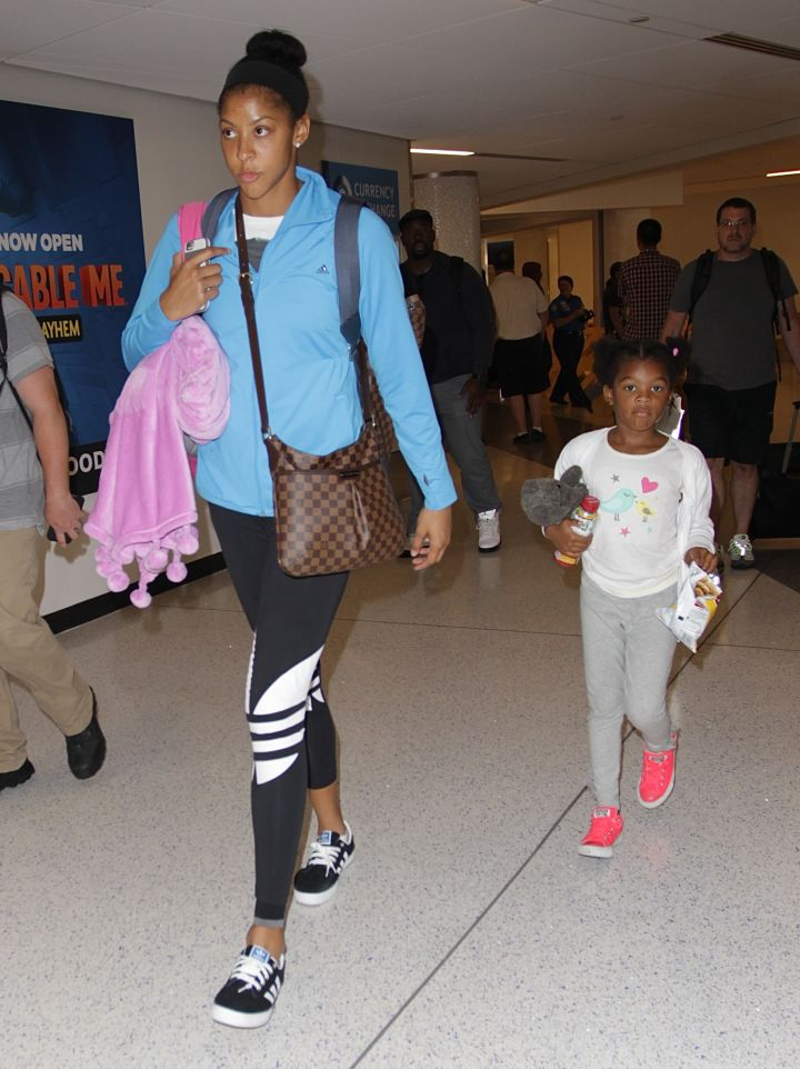 Candace Parker and her daughter Lailaa keep it casual at LAX.