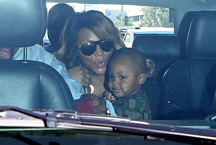 Tamar Braxton steals a smooch from her son Logan at LAX.