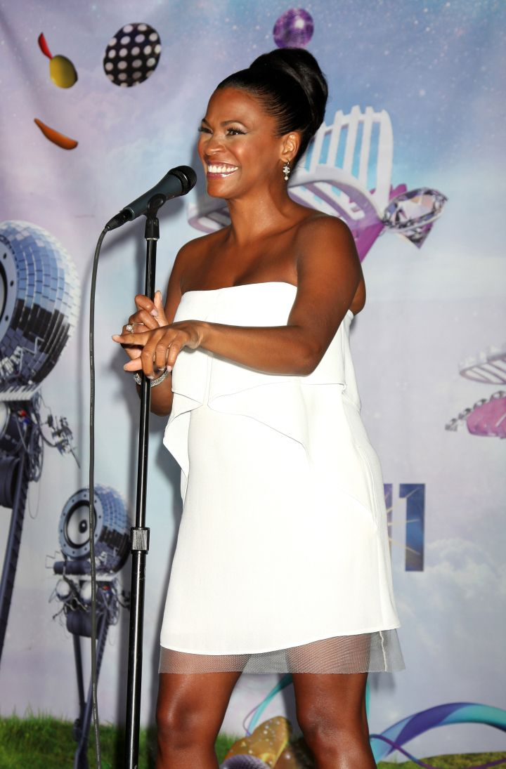 Nia Long has a flawless smile as she hits the stage in all white.