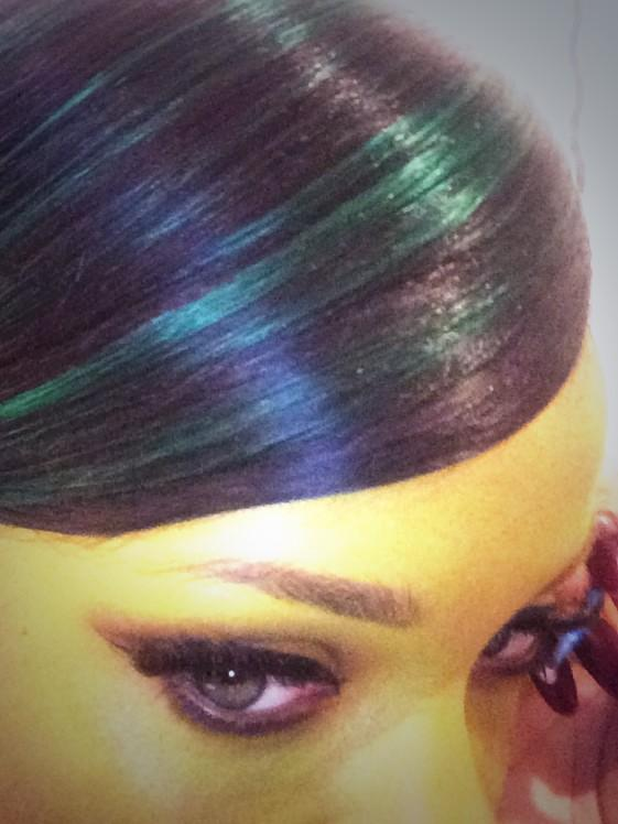 Rihanna dyes her hair green for the holiday.