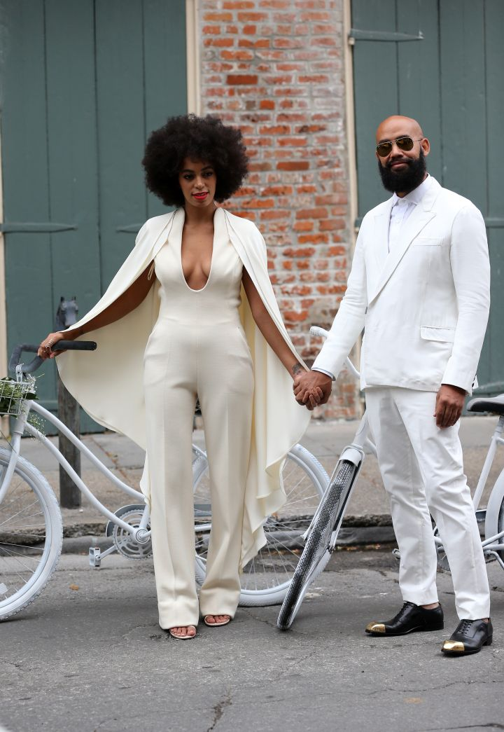Solange and Alan Ferguson arrive together on bikes for their wedding.
