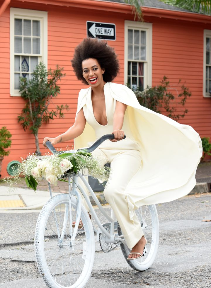 Blushing bride Solange peddles her way to the chapel to marry Alan Ferguson.