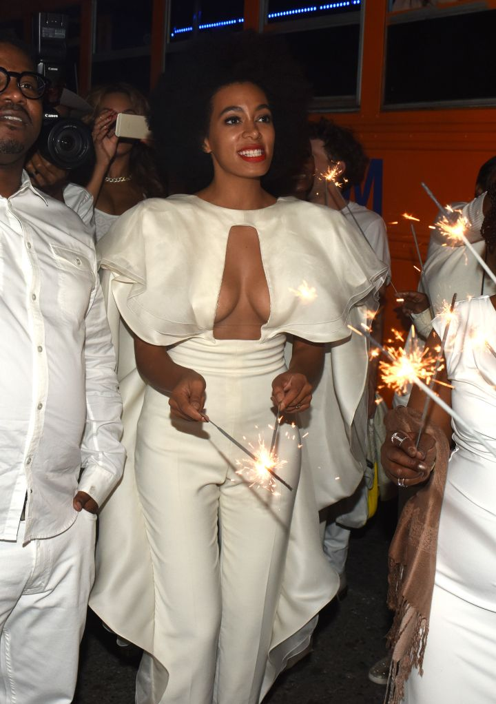 Solange outshines the sparklers in her all-white jumpsuit.