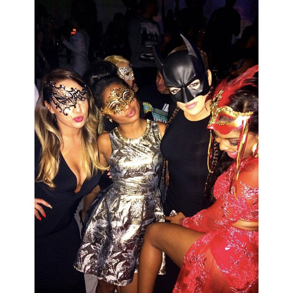 "Khloe Kardashian poses it up with her ""masked baes."""