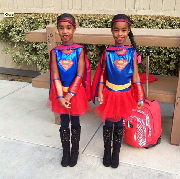 The twins go as superwomen!