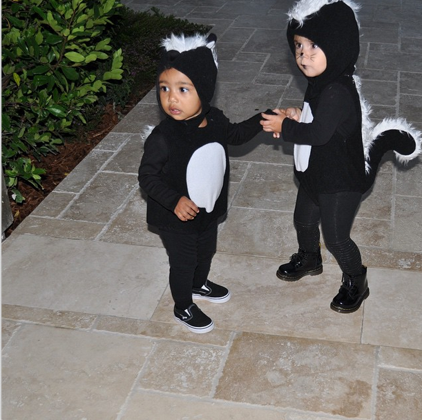 North West and Penelope Disick both dress as skunks!