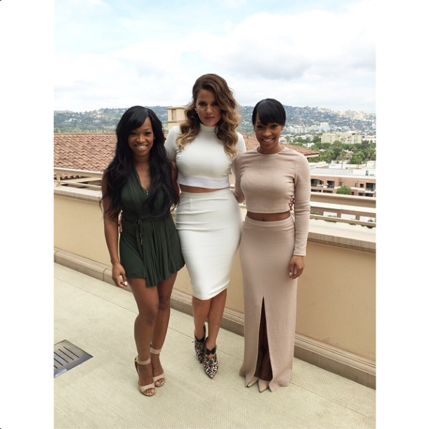Khloe poses with her besties at the baby shower.