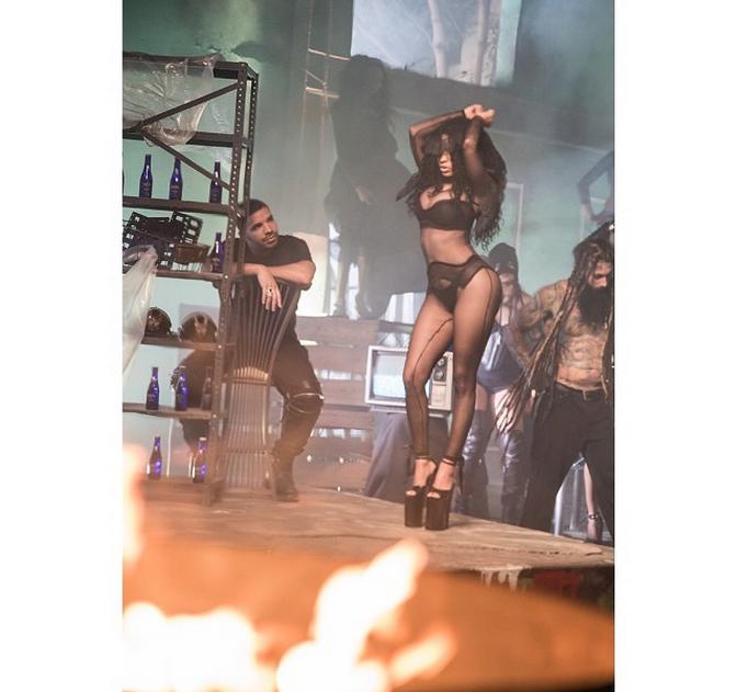 Nicki Minaj keep it blazing on the set of her new vid, literally.
