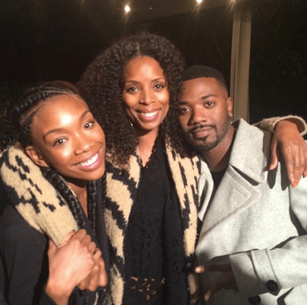 Brandy gets a photo in with the fam.