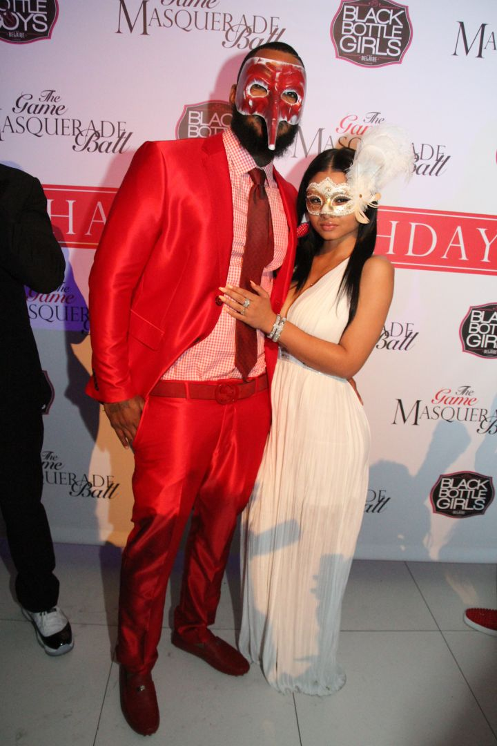 The Game and his rumored boo India Love pose on the carpet.