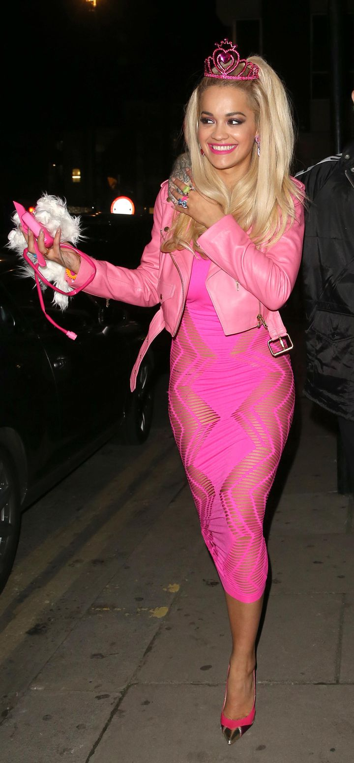 Rita Ora keeps it all pink for a Halloween party.