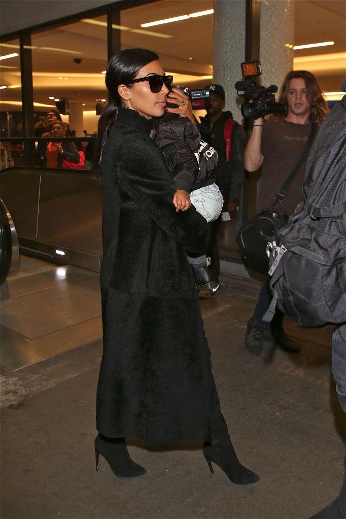 Kim Kardashian and North West depart Los Angeles at LAX