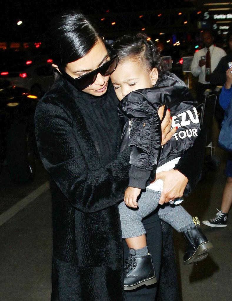 Kim Kardashian and baby North West at Los Angeles International Airport **NO DAILY MAIL SALES**