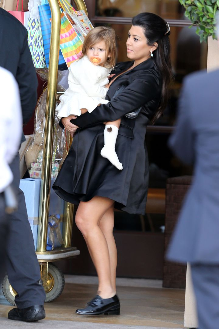 Kourtney and her baby girl Penelope leave the baby shower.
