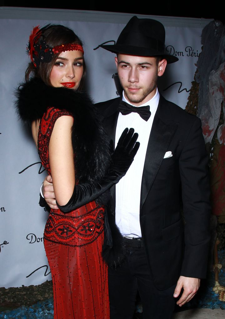 Nick Jonas and Olivia Culpo coordinate costumes as a couple.