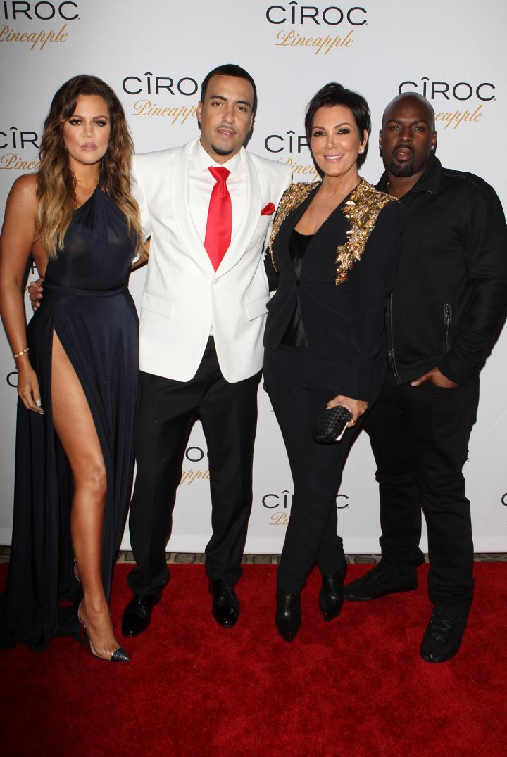 Khloe, French, Kris, and her boo pose together on the carpet.