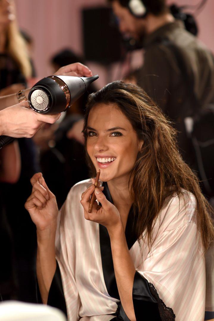Victoria's Secret model Alessandra Ambrosio is seen backstage prior to the 2014 Victoria's Secret Fashion Show.