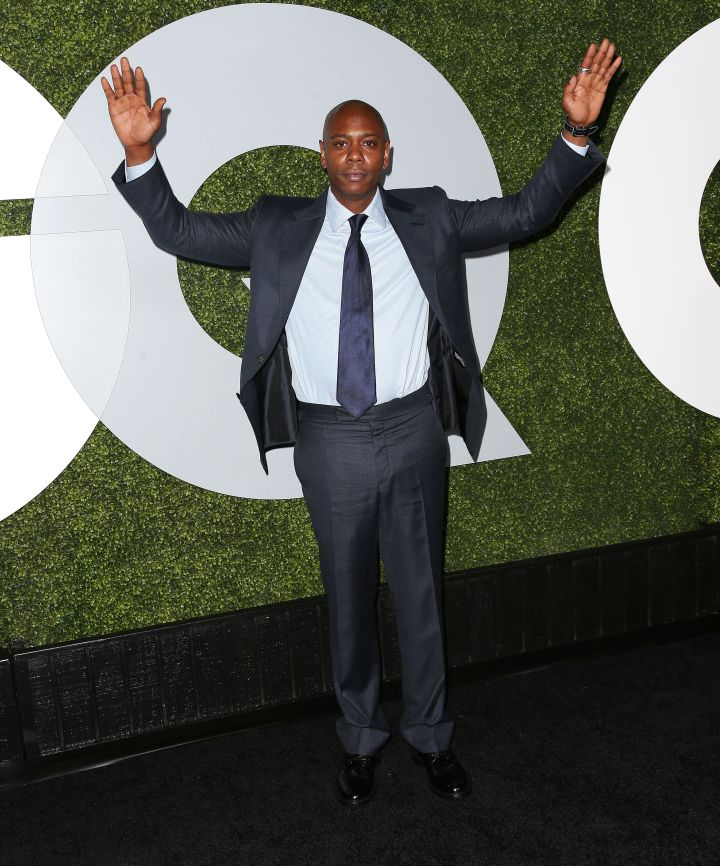 Dave Chappelle posed with his hands up for Mike Brown on the red carpet.
