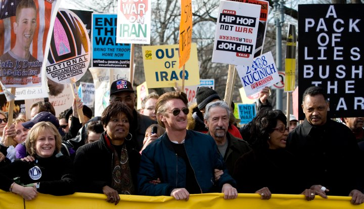 Actor Sean Penn and Reverend Jesse Jackson marched with activists during an anti-war rally.