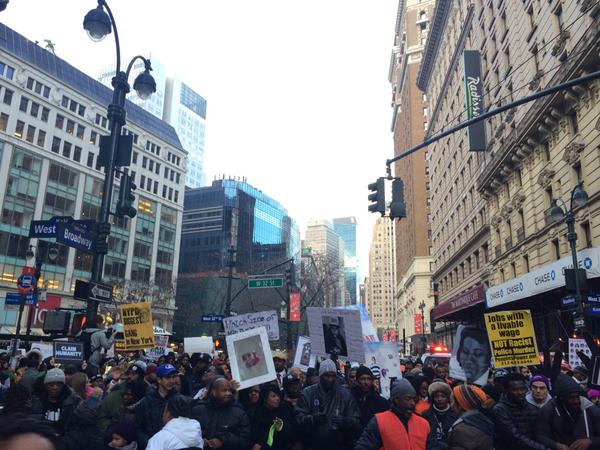 Protestors march up 5th Avenue.