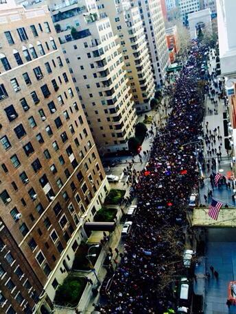 Thousands march together on their way to the NYPD headquarters.