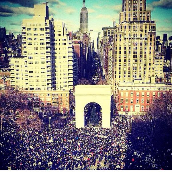 Thousands gather in Washington Square Park before marching uptown.