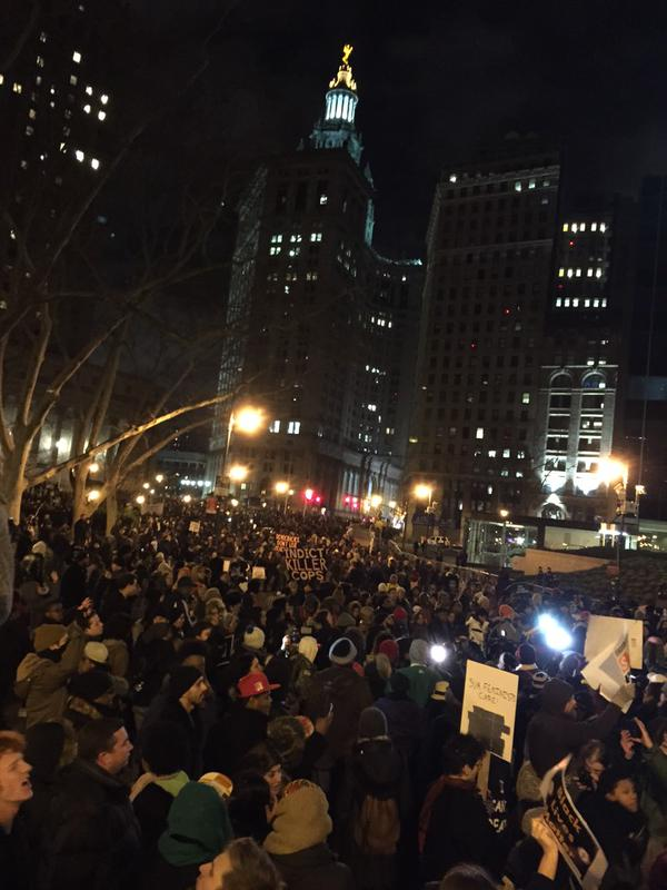 Thousands gather near the NYPD headquarters.