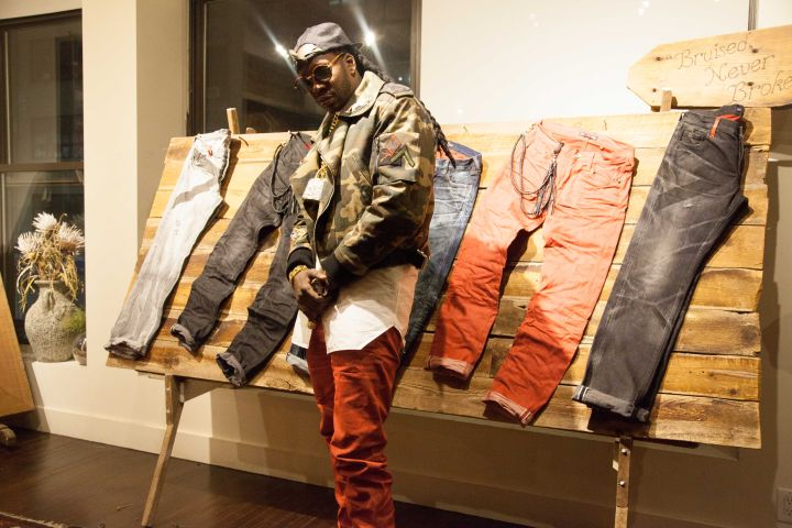 2 Chainz Posing With His Collection.