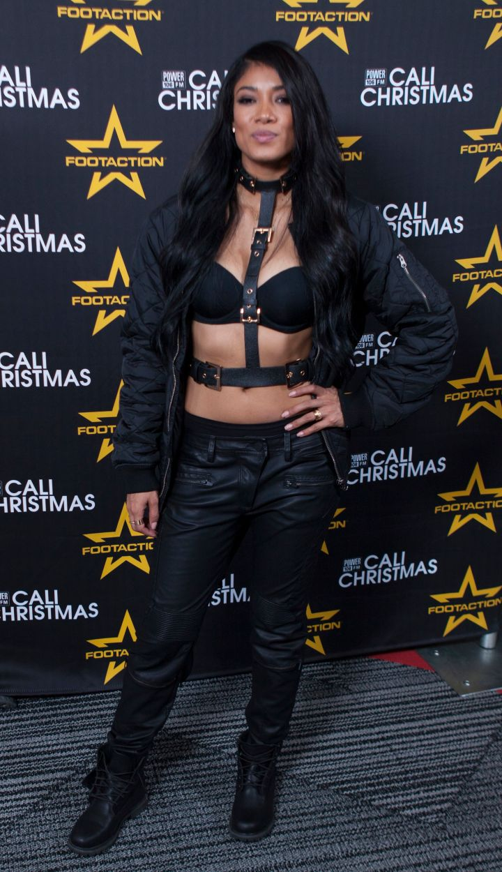 Mila J shows off her tomboy style at Power 106's Cali Christmas concert.