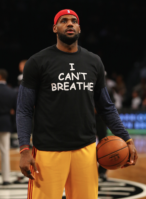 "Cleveland Cavalier LeBron James wears an ""I can't breathe"" tee in honor of Eric Garner, a 43-year-old grandfather choked to death by an NYPD officer."