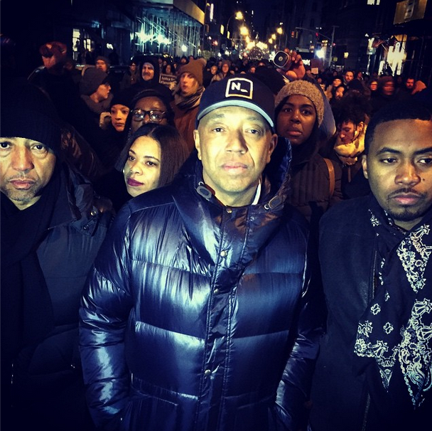 Kevin Liles, Russell Simmons, and Nas help lead the march in NYC.