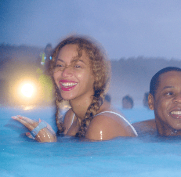 Bey and her hubby slip away for some relaxing time in the resort's hot tub.
